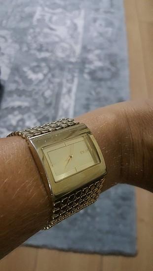 DKNY altın renkli bayan kol saati