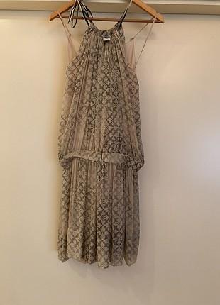 Belden büzgülü elbise